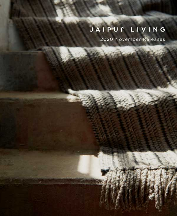 A textured rug lays on a set of stairs, in shadow.